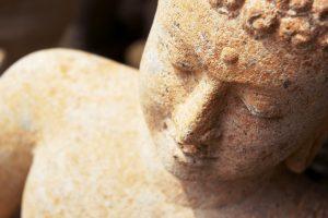 Red stone buddha, thailand